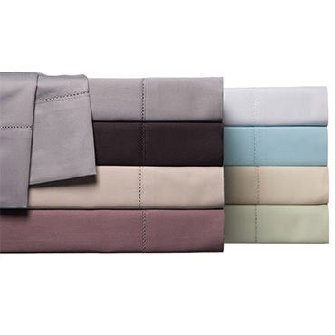 Stack of colorful Egyptian cotton sheets