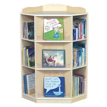 A natural wood corner bookshelf with three shelves, filled with colorful children's books