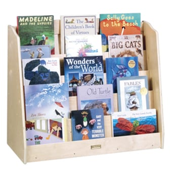 A natural wood short book display filled with colorful children's books