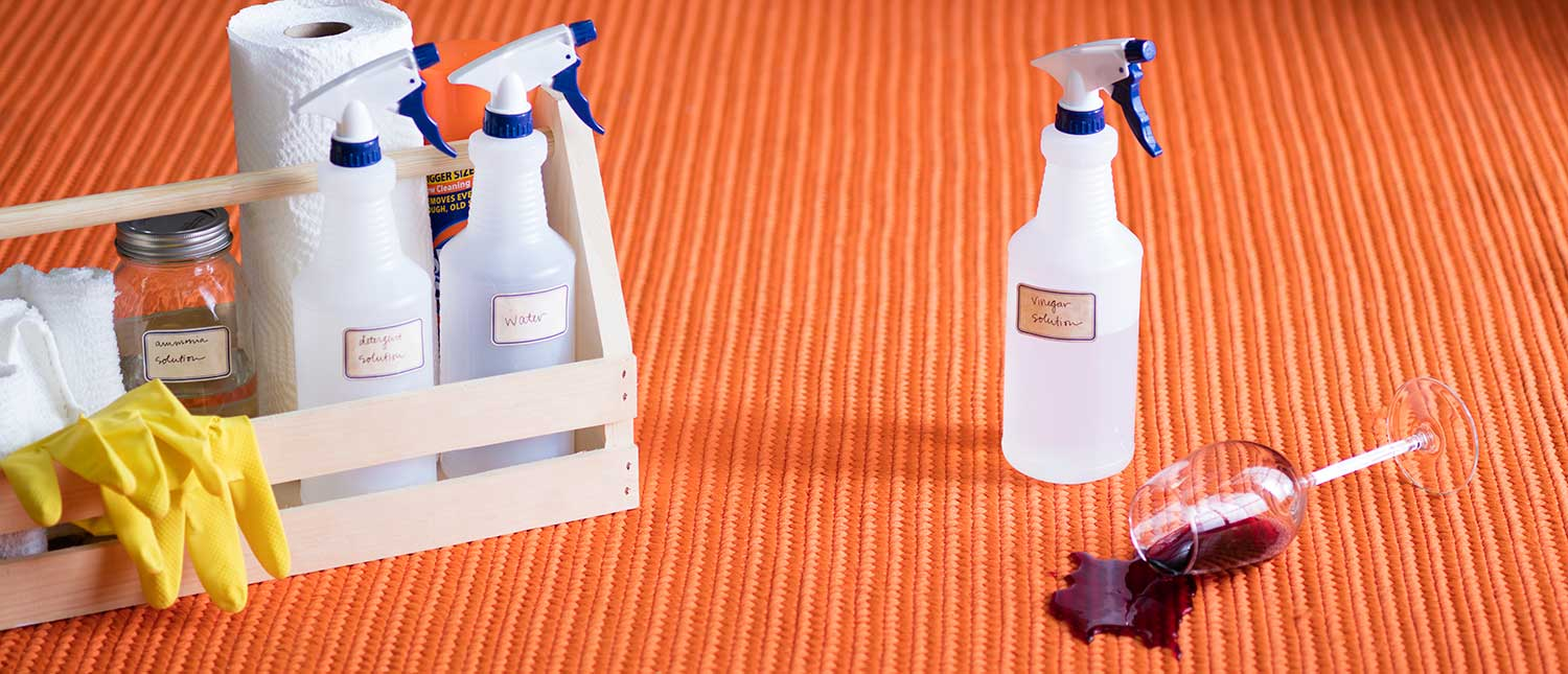 Spilled wine with a cleaning kit at hand