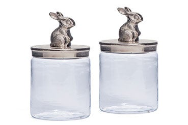 glass jar with silver lid and bunny figuring one top