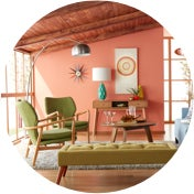 Mid-century modern living room with wall art and stylish chairs