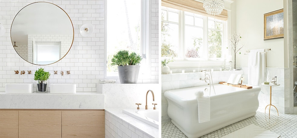 Close up of white soaking tub with bathroom accessories