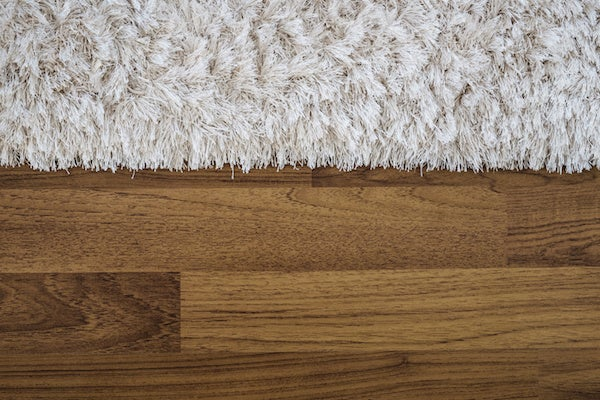 Shag rug edges on wood floor