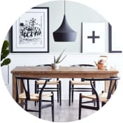 Scandinavian dining room with black and white wall art and a wooden dining set