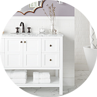 White vanity with a bathroom sink under a mirror