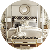 Glamorous bedroom with a large bedframe and decorative throw pillows