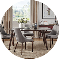 Wooden dining set with grey chairs and a vase of flowers