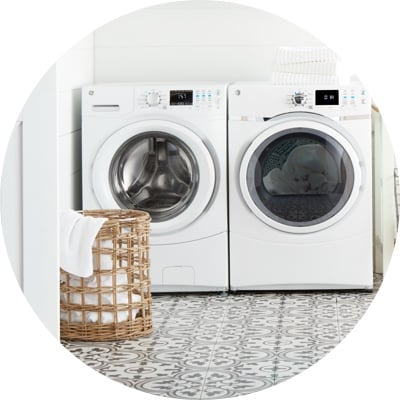 Laundry room with a white washer dryer set