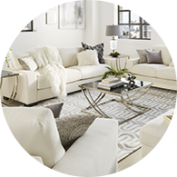 Living room filled with soft white sofas and armchairs