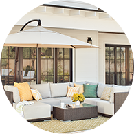 Large patio set on an outdoor rug beneath an umbrella