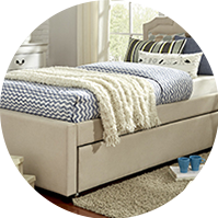 Bedframe and mattress in a small bedroom