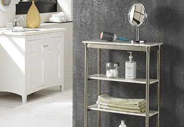 Polished bathroom shelves holding face towels, a hairbrush, and other bathroom essentials
