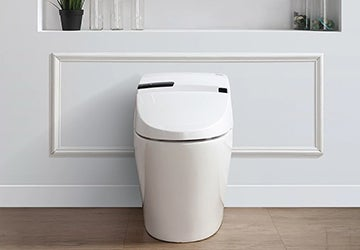 White toilet in a bathroom with a hardwood floor