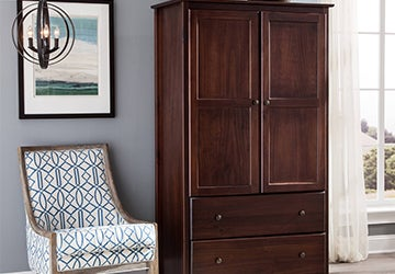 Tall wooden armoire with a reddish brown wood stain