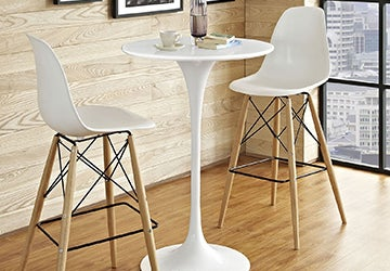 Postmodern bar table with two white bar stools