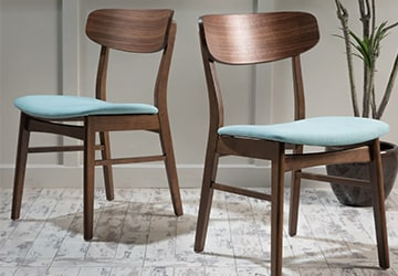 Wooden dining chairs with blue seats