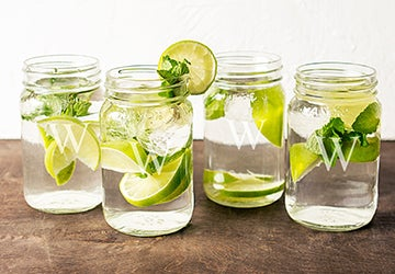 Monogrammed glass mugs with lime garnishes