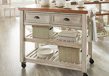 Wooden kitchen bar with drawers, boxes, and dinnerware