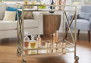 Glam barstool with polished copper barware and glass decanters