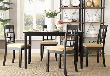 Wood dining set with padded seats and white tableware