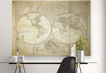 Stylized map of the world hanging over an office desk