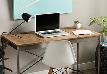 Laptop on a wooden desk in a home office