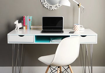 White desk with a laptop and kids' books