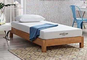 Child's mattress on a wooden platform bed