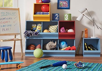 Colorful storage shelves full of kids' toys in a playroom