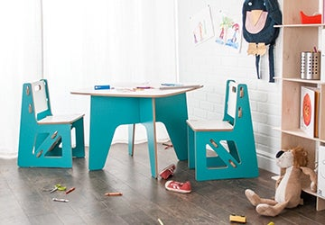Wooden table and chairs in a kids' playroom