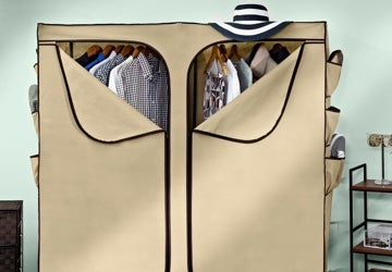 Clothes hanging in a fabric storage bin