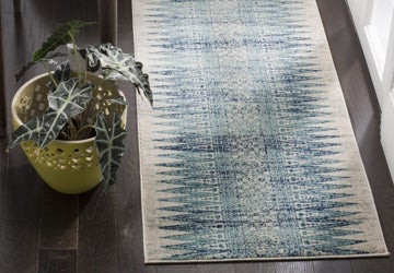 Runner rug with a geometric pattern in shades of blue, green, and cream