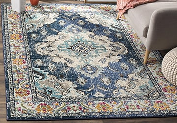 Stylishly distressed area rug with an elaborate floral pattern