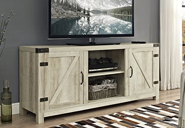 Wooden entertainment center holding up a wide-screen television
