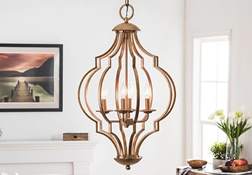 Polished gold chandelier with candelabra style lighting
