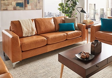 Brown sofas and loveseats gathered around a wooden coffee table