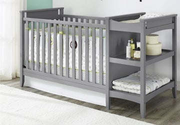 Gray baby crib with a changing table attached