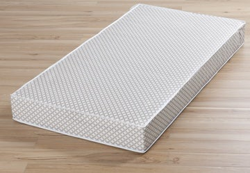 Crib mattress with a gray lattice pattern