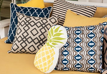 Outdoor pillows with various patterns in a variety of colors