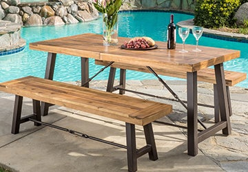 Metal and wood dining set beside a swimming pool