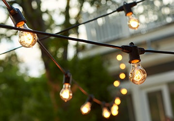 String lights hanging over an outdoor space