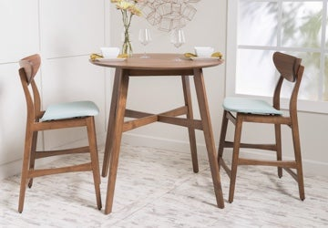 3-piece wooden dining set in a shite nook