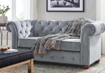 Traditional loveseat with rolled arms in a small living room