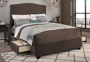 Brown bed with sliding drawers built into it