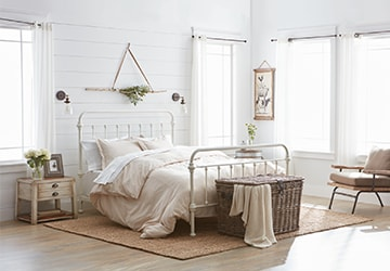 Country-style bedroom with chic furniture and decor accents
