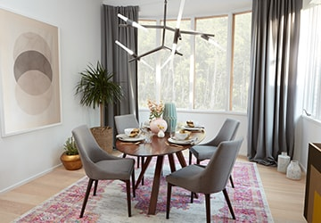 Nook with a dining set surrounded by diverse and eclectic decor