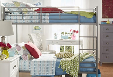 Kids' room with a bunkbed, a nightstand, and a gray dresser