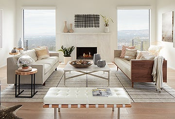 Beige living room with sofas, a coffee table, and a geometric rug