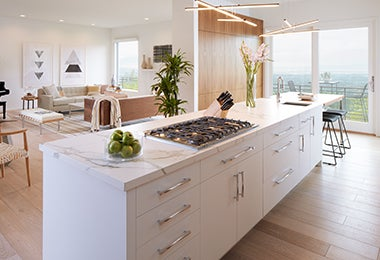 Kitchen island with a knife block and stylish task lighting